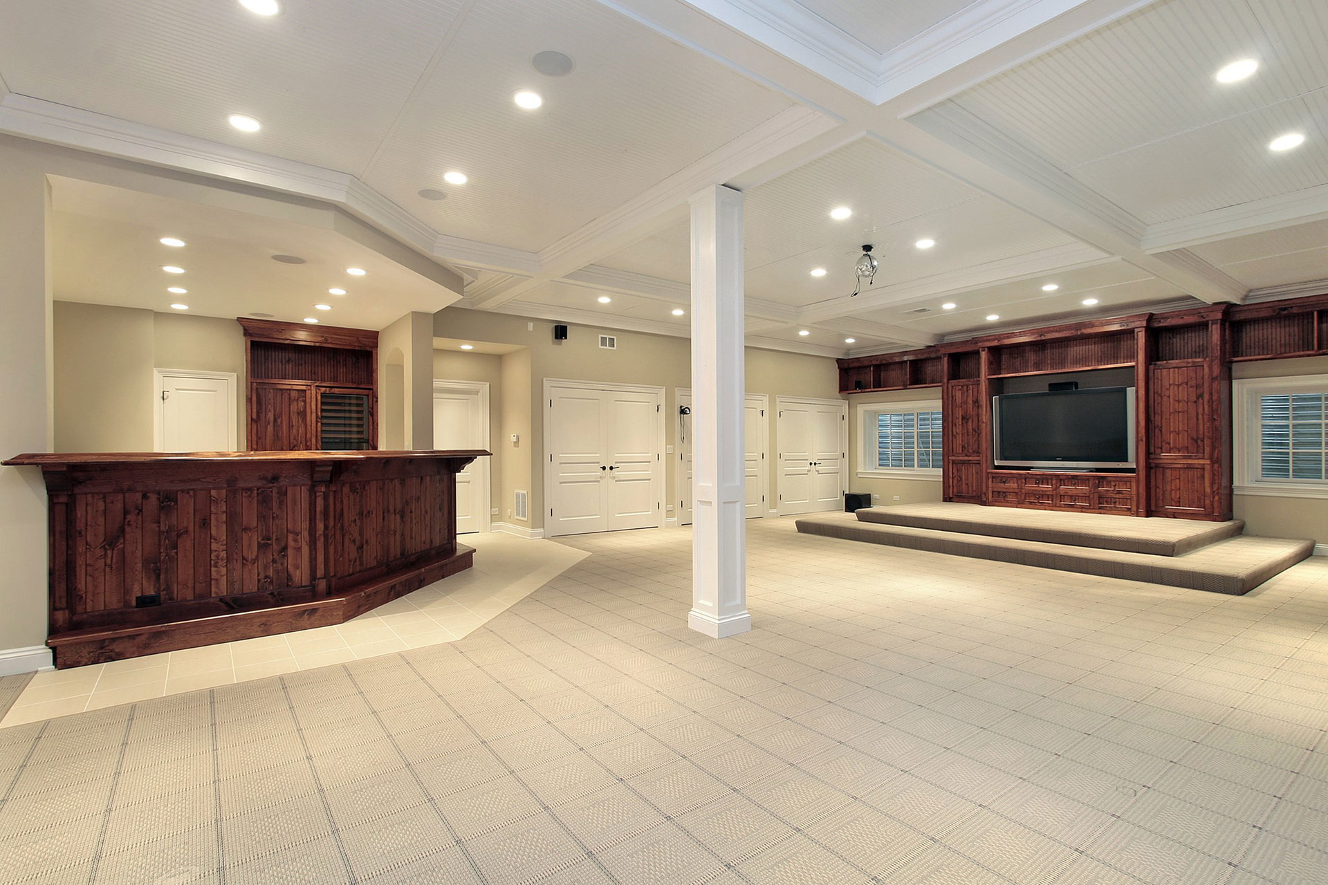 renovated basement with wooden bar and wall unit