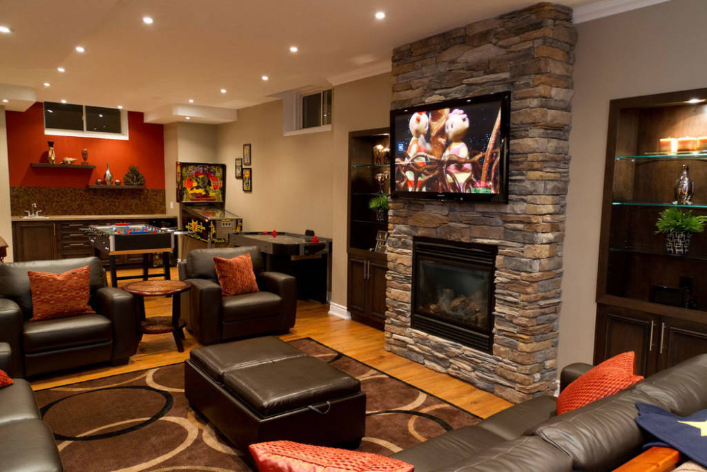renovated basement with a fireplace