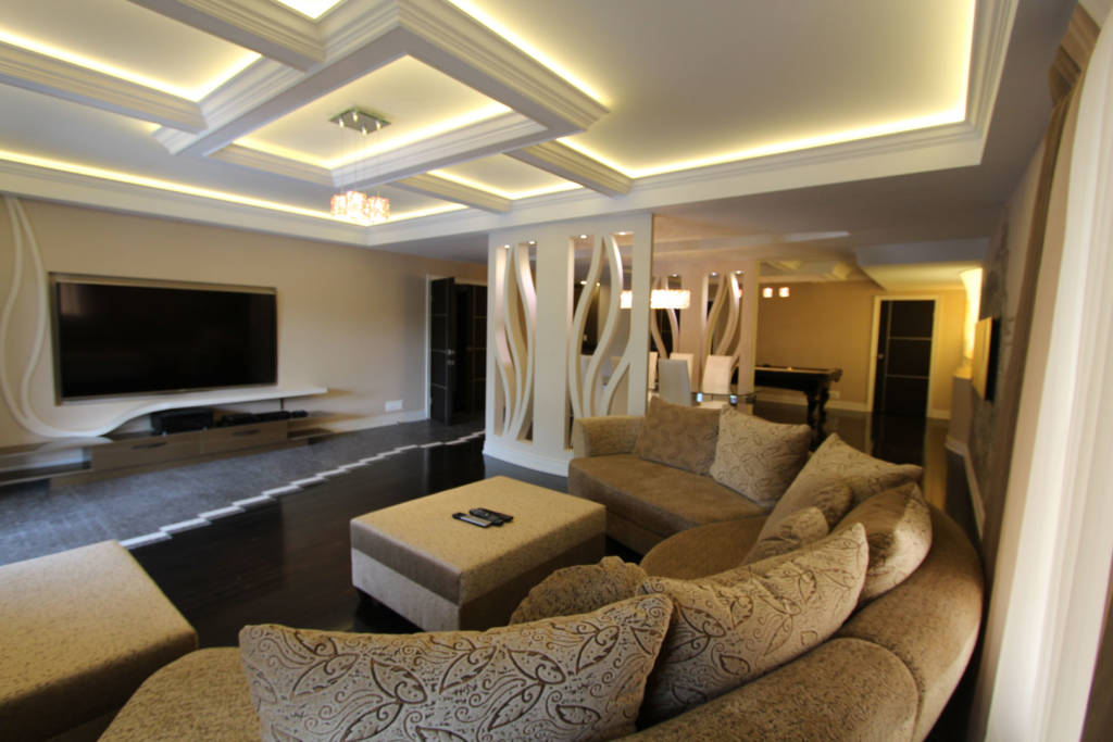 renovated basement with waffle ceiling moulding