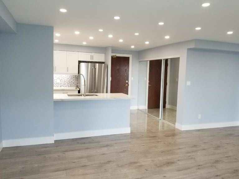 small kitchen with blue wall painting in condo - kitchen renovation vaughan