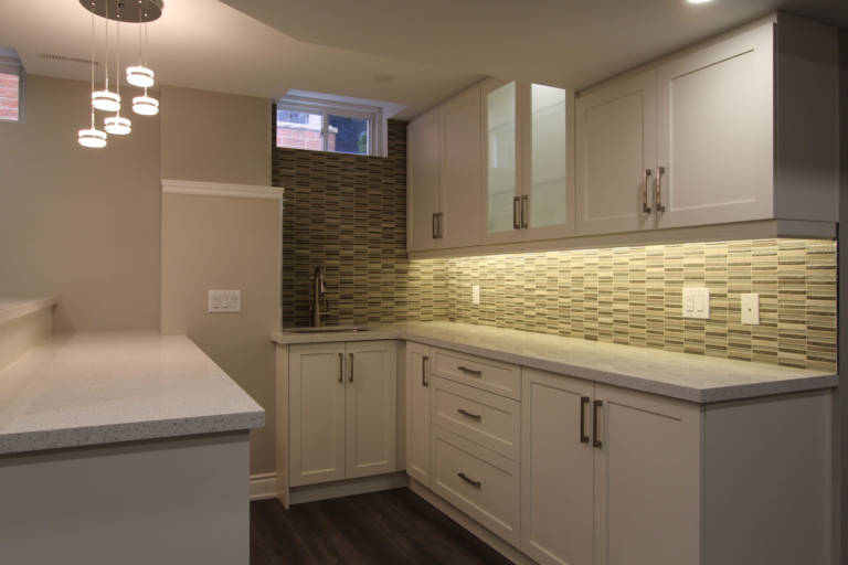 small kitchen with baseboard trim and back lit kitchen cabinets - kitchen renovation vaughan