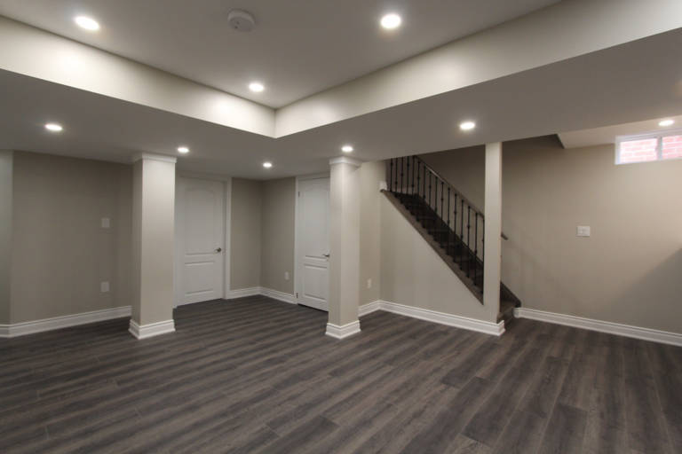 open space basement with multilevel ceiling and potlights - basement renovation innisfil