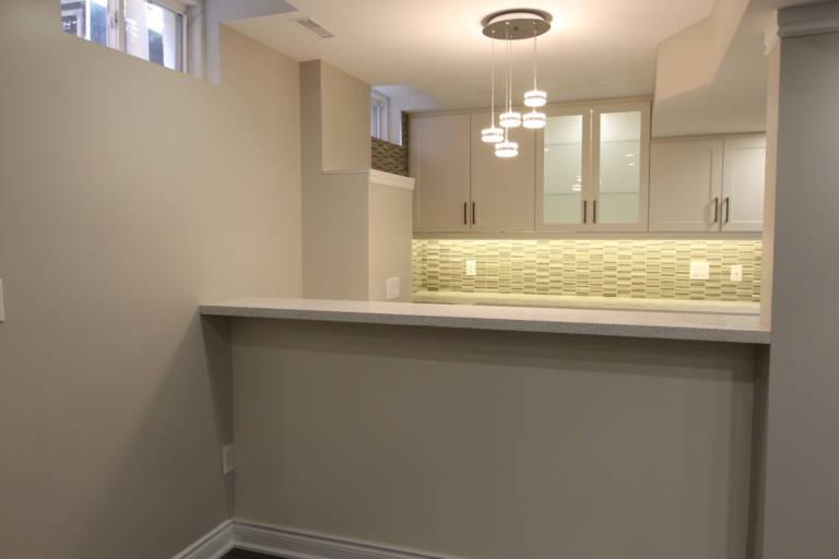 basement kitchen remodeling with green tile back splash - basement renovation king city