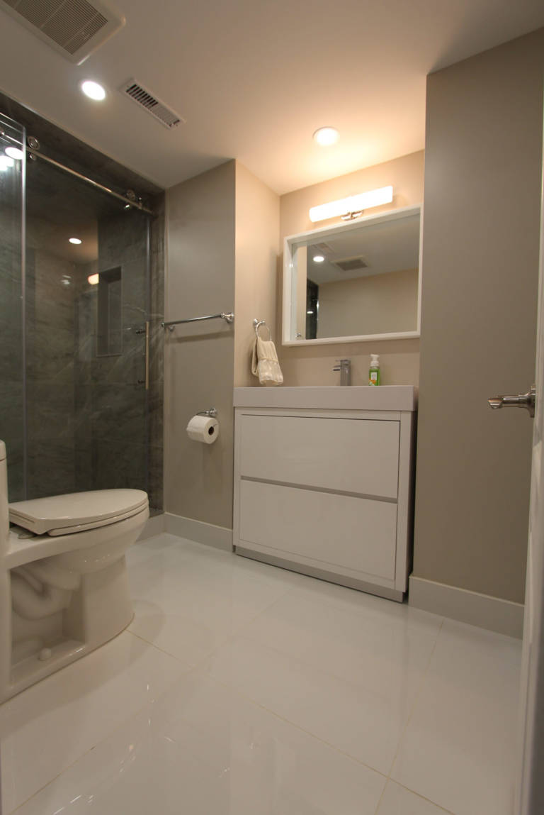 custom small bathroom with beige wall painting and walk in shower - bathroom renovation contractors toronto