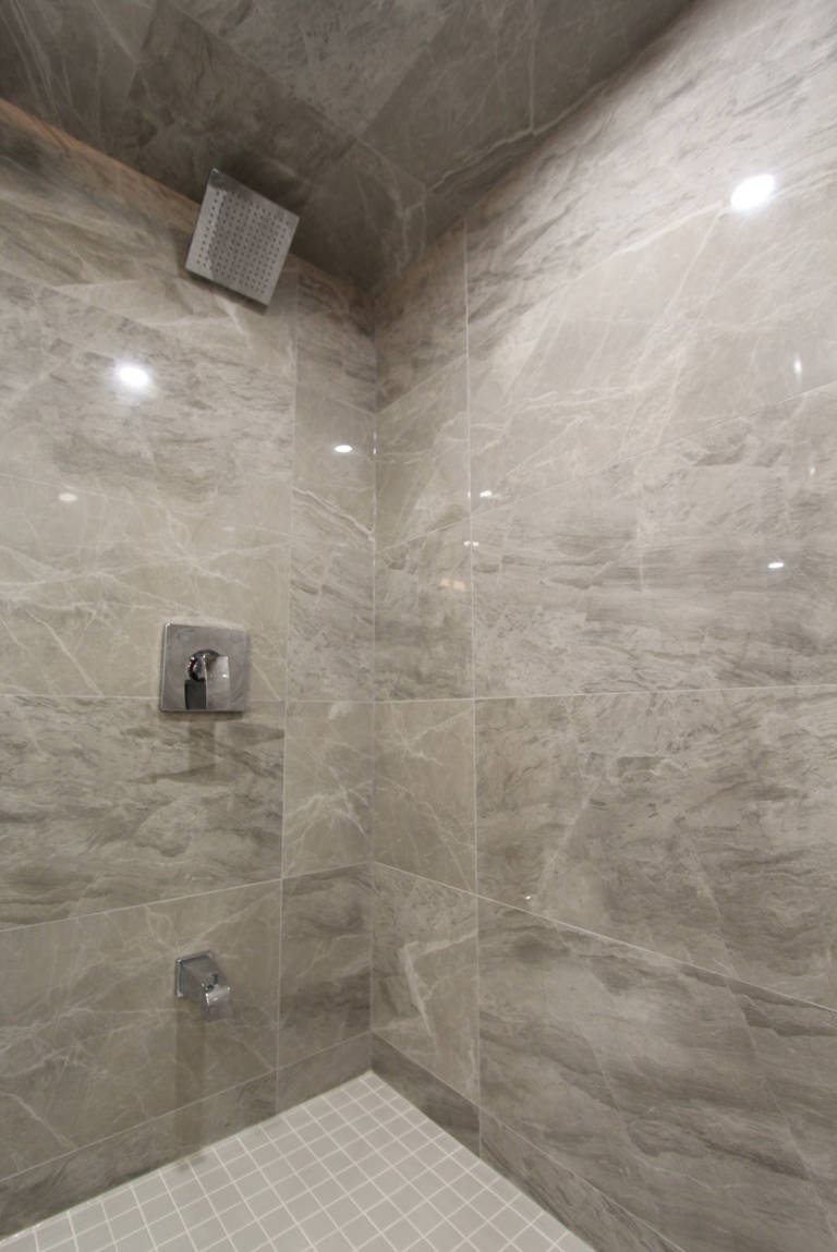 walk in shower with marble wall tile decor - remodeling bathroom