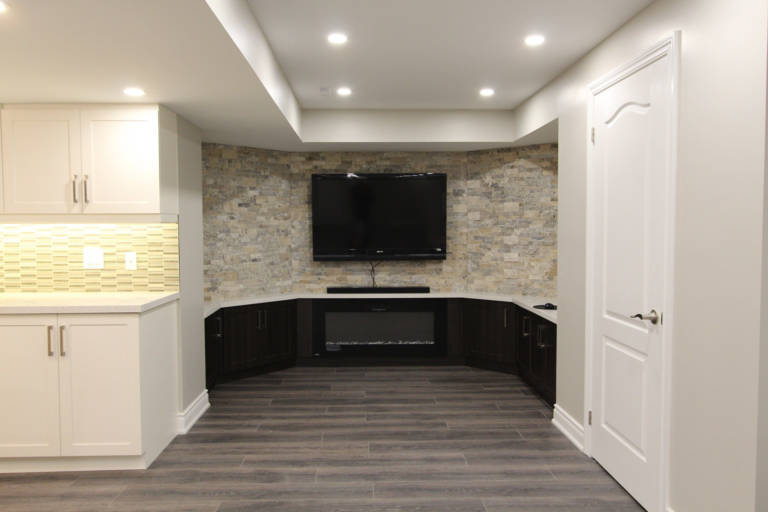 amazing family room with build in entertainment unit and 3d custom wall decor - basement ideas