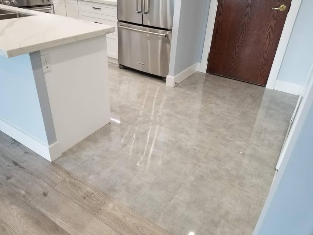 high gloss marble tile floor in condo apartment - condo renovation toronto