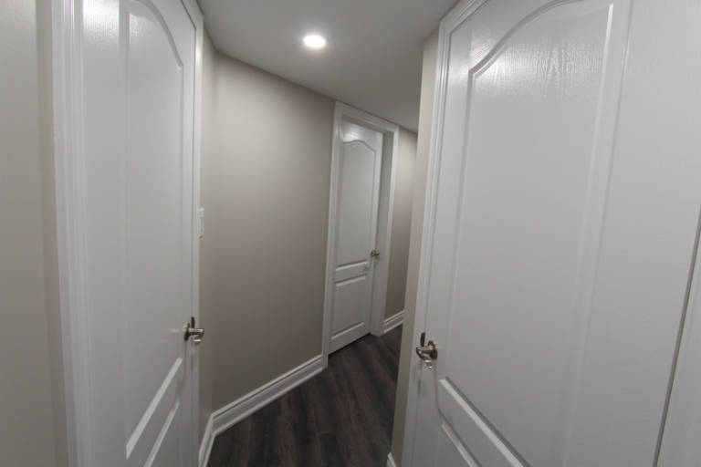 basement hallway door installation and baseboard trim install - basement renovations toronto