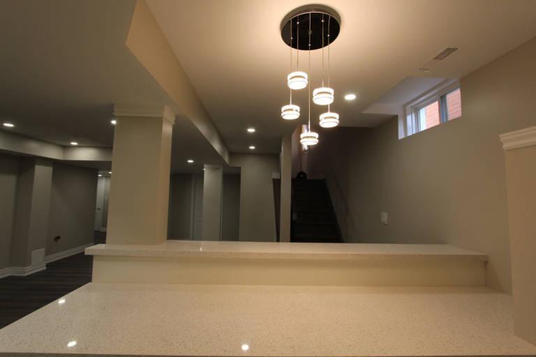 custom chandelier in small basement kitchen - remodeling kitchen aurora