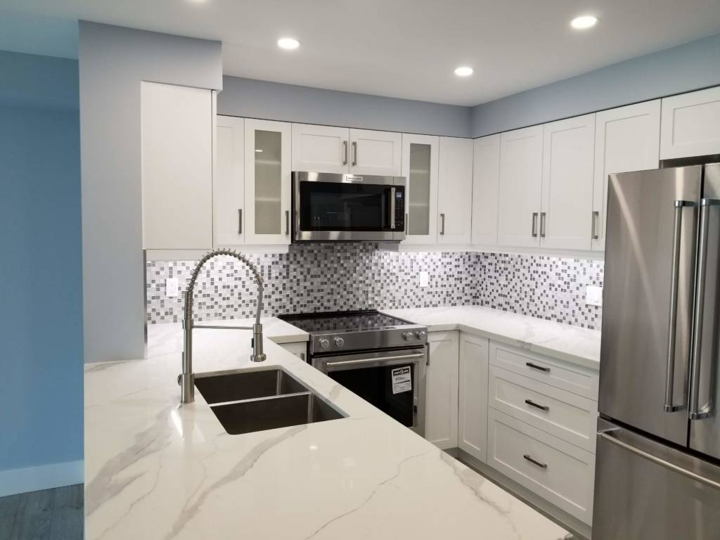 amazing small kitchen with build in appliance and back lit white cabinets - remodeling kitchen