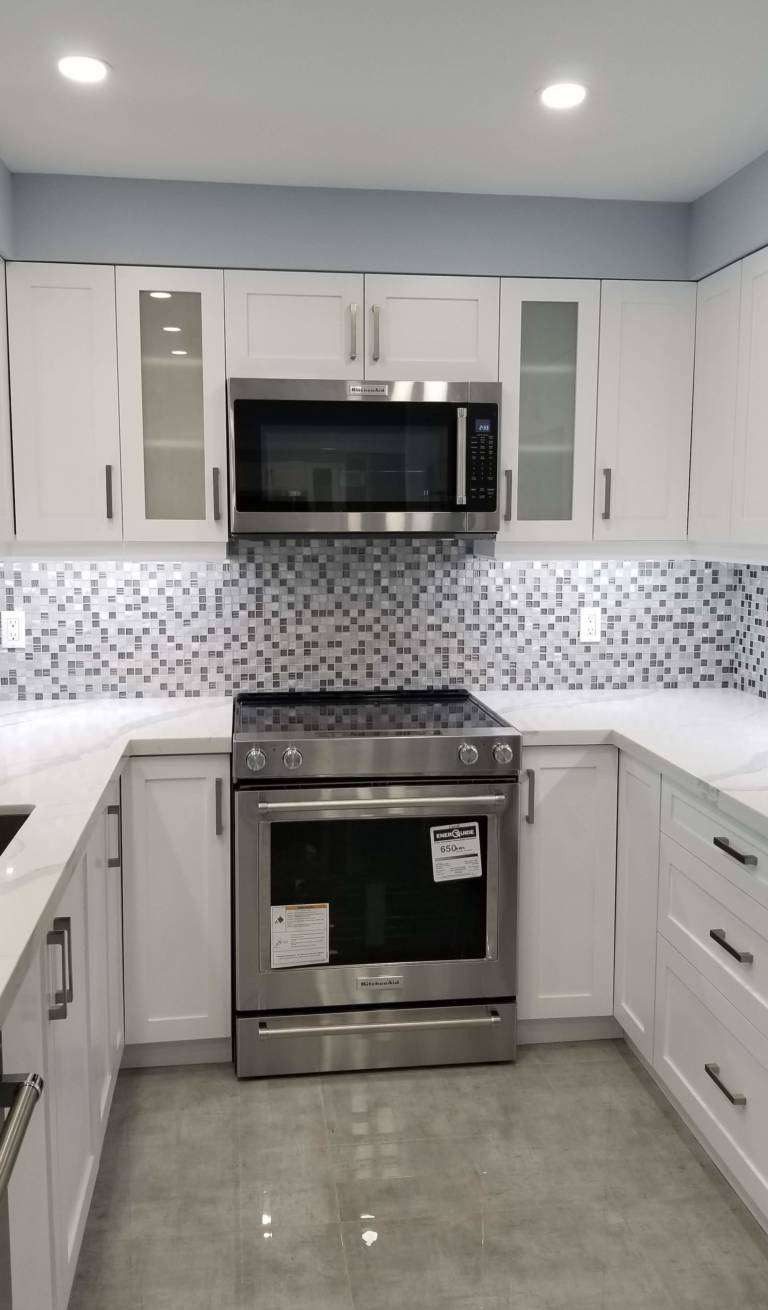 luxury kitchen with blue wall painting and marble floor tiles - kitchen renovation vaughan