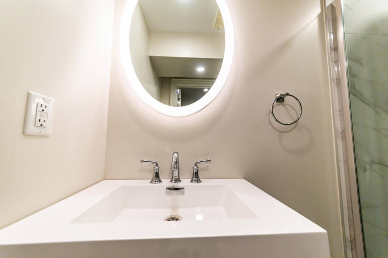 back lit small mirror and walk in shower in amazing bathroom - remodeling bathroom