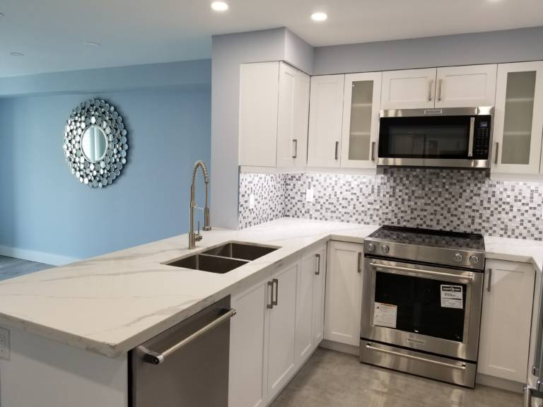 condo kitchen with white back lit cabinets - remodeling kitchen