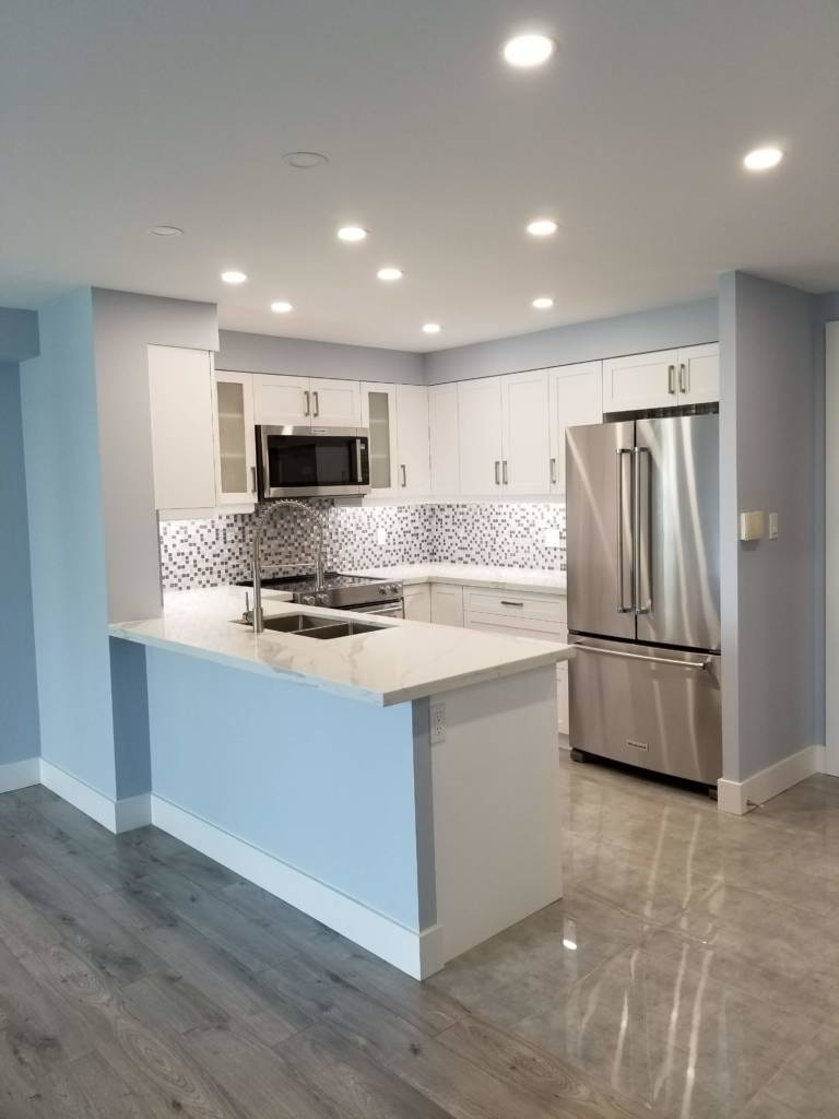 condo small kitchen with high gloss floor and pot lights - remodeling kitchen