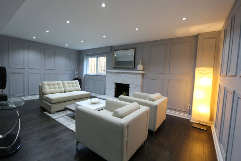 Custom Basement Family Room With Build in Fireplace - Home Renovation Contractors Schomberg